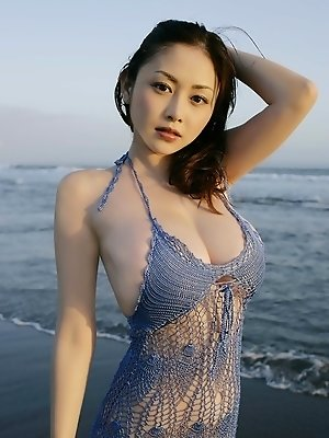 Anri Sugihara Asian with huge melons shows curves at the sea