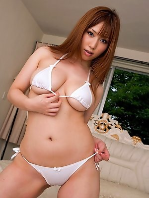 Beautful gravure idol bride with plump boobs posing in lingerie