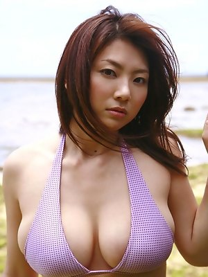 Flirtatious asian idol soaping up her curvy big breasted body