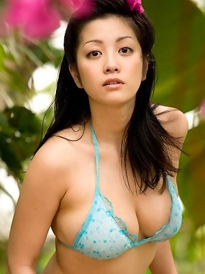 Gravure idol looks saucey and hot as she swims around in a bikini